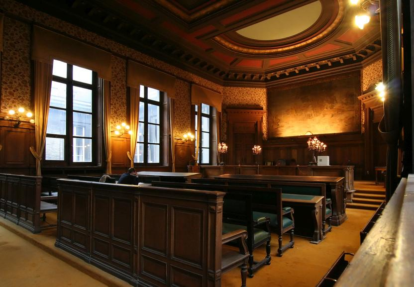 Court room in the Palace of Justice in Brussels, with a lawyer preparing his case